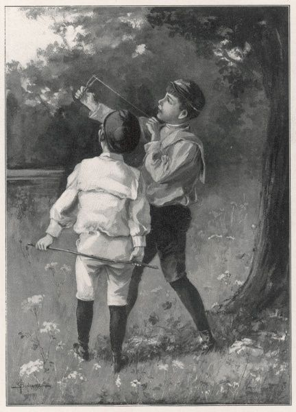 A boy demonstrates a catapult to a friend