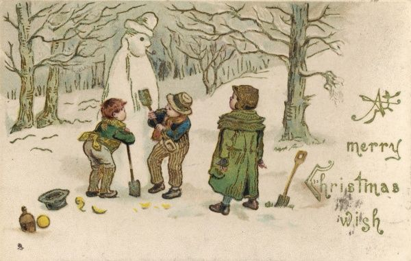 Three boys building a snowman in the woods
