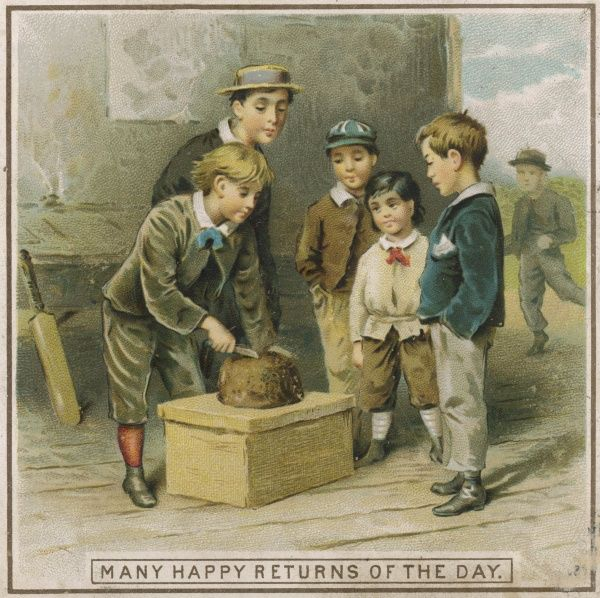 Six schoolboys prepare to eat some birthday cake