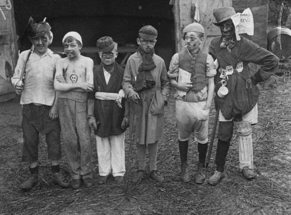 Six boys from a Boys Club in wonderful fancy dress costume. Characters include, a pirate, an old gentleman and a homeless man with a wooden leg