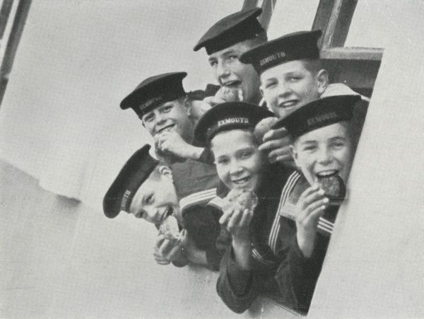 Boys eating buns on the Training Ship Exmouth, operated from 1876 by the Metropolitan Asylums Board on the Thames off Grays, Essex. In 1903, the original vessel became unsafe and was replaced by an identical ship made of iron and steel. Boys aged 12-15
