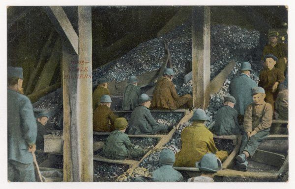 Boys picking slate out of mined coal, in an American mine