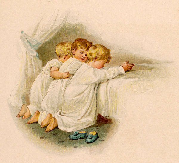 Three angelic little boys kneel side by side to say their evening prayers