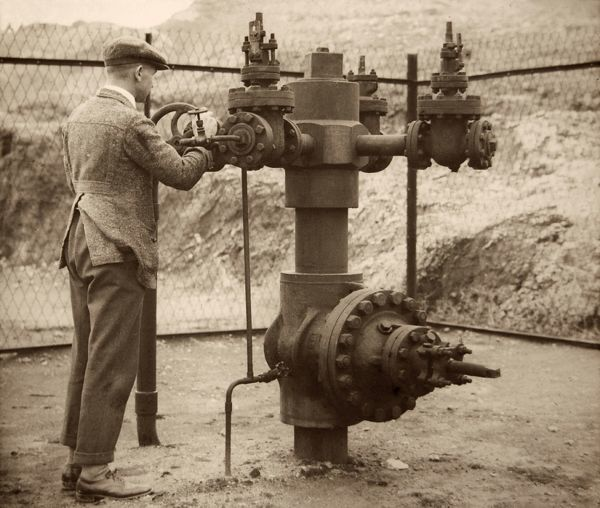 A British Petroleum employee opens the flow valves of an oil plant in the Middle East (likely to have been in Iraq or Iran)