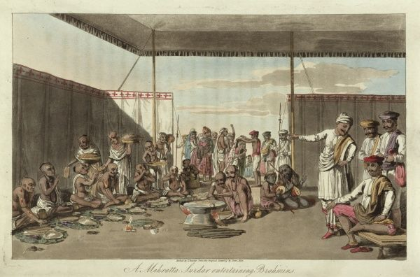 A Mahratta Surdar entertaining Brahmins. Brahmins at a feast in a Maratha Camp. Some are playing musical instruments while others are eating, and servants are carrying dishes of food. A Maratha or Mahratta is a member of one of the major Hindu Kshatriya