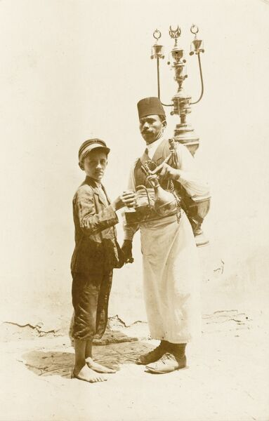 Tea Seller in Braila, Romania. The Turkish men give an idea of the extent of Ottoman Empire in the early 20th century)