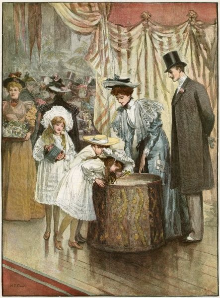 Children plunge their arms into the Bran Tub to obtain their present at a party