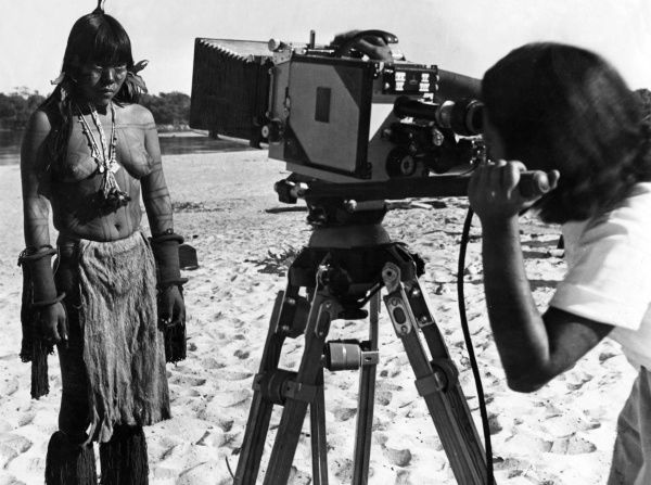 A camera woman films a close- up of the winner of a beauty contest held at Rio de Janeiro, Brazil, South America. Date: 1930s