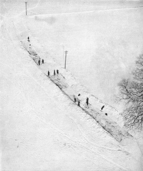 An aerial view showing squads of men cutting their way through drifts to the village of Bredhurst which, although only four miles from Chatham in Kent, was for a short period completely cut off from the outside world