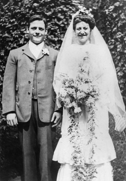 A happy English bride and groom. Date: 1890s