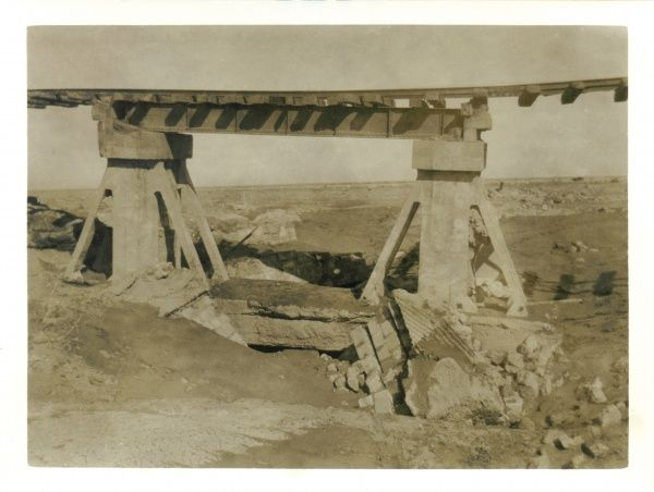 View of a bridge that has been damaged by explosives, somewhere in Iraq