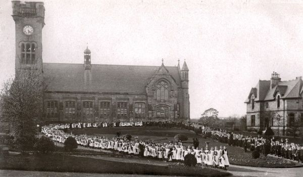 Children stream out from the church at the Orphan Homes of Scotland, Bridge of Weir. Date: 1910