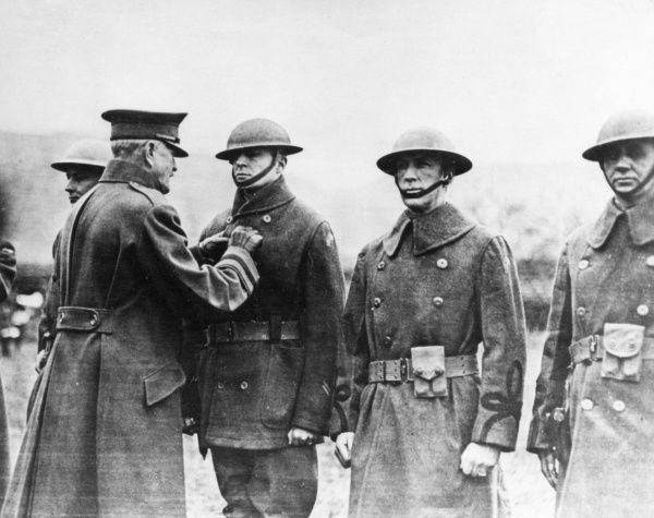 Brigadier General Douglas Macarthur (1880-1964), American army officer of the 84th Brigade, 42nd Division, receiving the DSM (Distinguished Service Medal) from General John Pershing (1860-1948) at Remagen in Rhenish Prussia, Germany, a few months