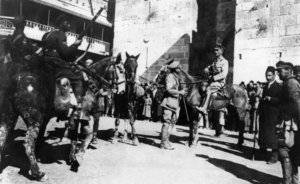 Brigadier General (later Major General) Sir David Watson (1869-1922) of the Canadian 180 Infantry Brigade on his arrival in Jerusalem during the First World War. He can be seen standing, centre, with walking stick and pipe in hand. He was also a journalist