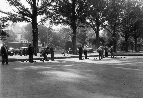 Is there anything so restful as a game of bowls on a beautiful day? Several matches in progress in Brighton. Date: 1950s