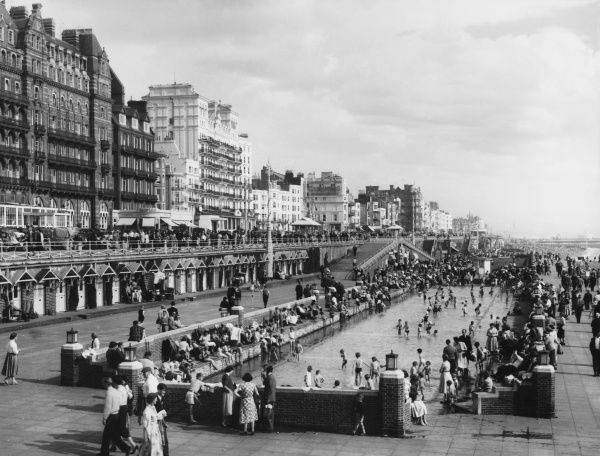The seafront and promenade, Brighton, Sussex, with the children's paddling pool in the foreground