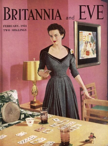 Front cover of Britannia and Eve featuring an elegant lady in a smart 1950s dress (with typical full skirt and nipped in waist) standing by a table where a game of cards is in progress