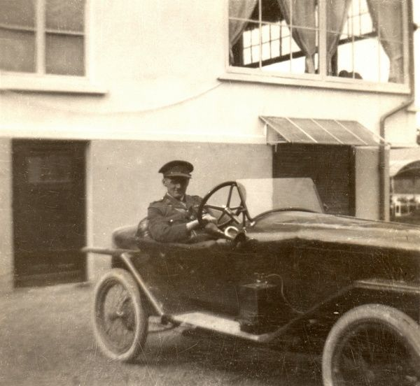 British Army Officer in a sporty coupe
