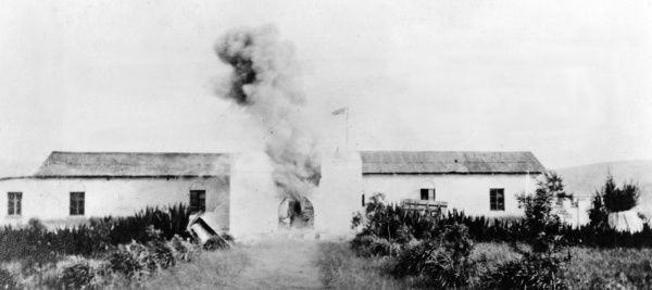 British attack on Fort Dschang, German Cameroon, west central Africa, during the First World War. Showing the blowing up of the main gateway. Date: 1914