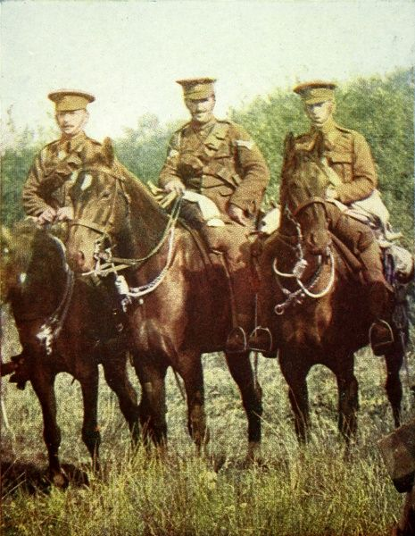 A photograph of Dragoon guards of the Queen's Bays mounted during an exercise. The colour image was published by the Illustrated London News to show their readers how the British khaki uniforms appeared against a European landscape