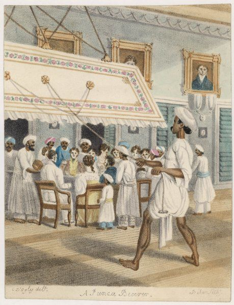 The British dine while a punkah-wallah cools the air : the servants seem to outnumber the guests