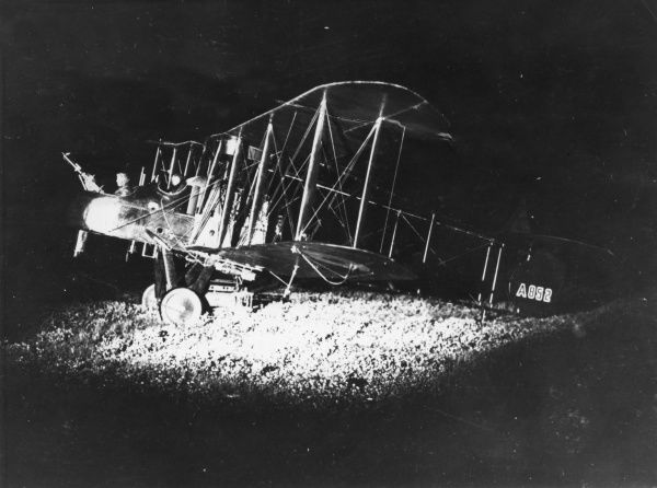 A British FE2B night bomber biplane with a 160hp Beardmore engine belonging to No. 100 Squadron RFC, seen here floodlit on the Western Front during the First World War. Date: 1914-1918
