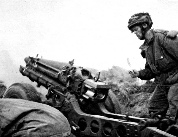 Photograph showing a soldier of the British First Airborne Division firing a 75mm gun at an enemy position near Arnhem, September 1944