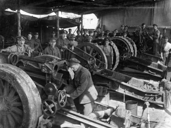 A British gun 'hospital' or workshop in Flanders for the repair of Howitzers, with artillerymen, during the First World War. Date: 1914-1918