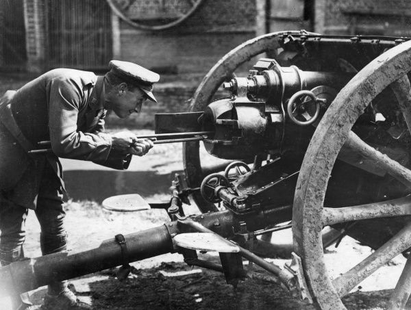 A British gun being repaired by a 'gun doctor' in an ordnance workshop in Flanders during the First World War. Date: 1914-1918