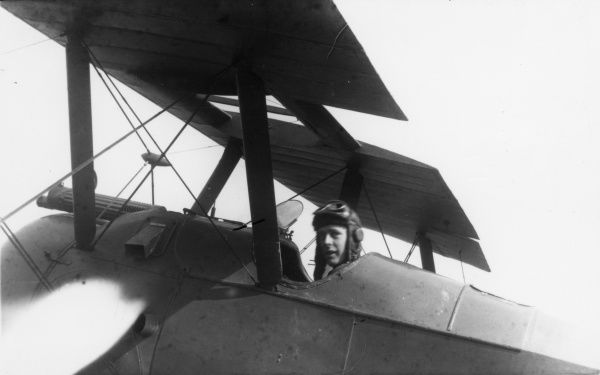 A British pilot in the cockpit of his biplane during the First World War. Date: 1914-1918