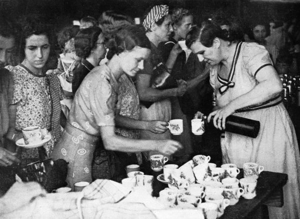 British refugees from Penang, Malaya, on their way to Singapore, are provided with refreshments by local residents at Ipoh Station, in Perak. Penang was taken by the invading Japanese forces on 17 December 1941 following the British withdrawal Date