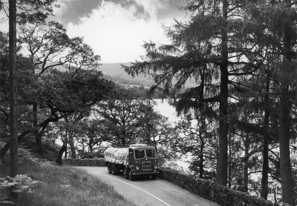A British Road Services truck drives along a winding lane alongside Ullswater, Westmorland, Lake District. Photograph by Heinz Zinram