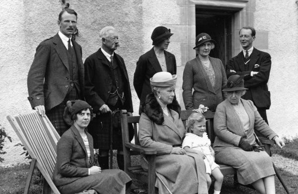 At Elsick House, Scotland in 1931: (l to r in front) Lady Maud Carnegie (younger sister of the Duchess of Fife and a granddaughter of King Edward VII), Queen Mary holding Maud's son James, Master of Carnegie, Princess Helena Victoria of