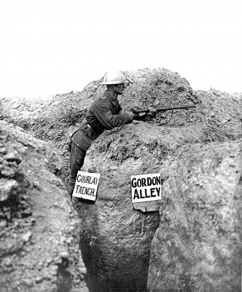 A British sentry standing guard over the intersection of two trenches on the Western front, September 1916