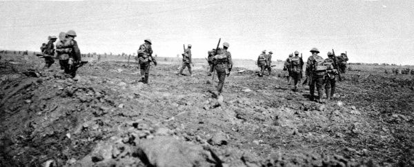 Soldiers are shown marching to reinforce a British attacking force in France, September 1916. The advance was part of the greater British Somme offensive which began in July of that year