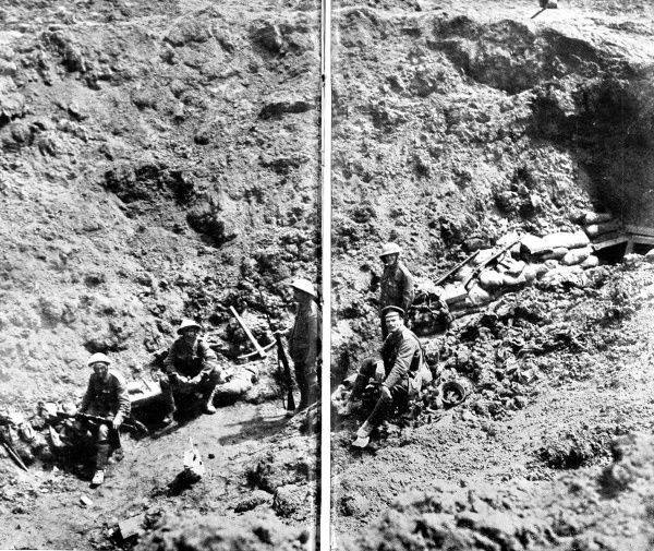British soldiers are pictured in a crater captured from the German army. The crater was created by the explosion of an Allied mine buried beneath enemy lines