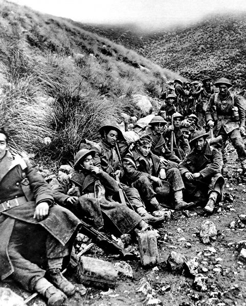 Photograph showing a group of British infantry taking a break, near Monte Camino, Italy, 1943. This unit had just been involved in six days of continuous fighting, storming strongly defended German positions on Monte Camino and Monte Maggiore