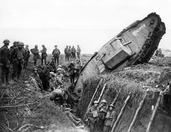 Men of the 1st Leicester Regiment, 6th Division, in and around a captured German second line trench, one mile west of Ribecourt, northern France, during the Battle of Cambrai, First World War. A tank of H Battalion, with the name Hyacinth painted on its side