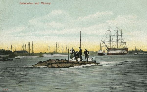 One of the earliest submarines in the Royal Navy in Portsmouth harbour, with Nelson's 'Victory' in the background. Date: circa 1910