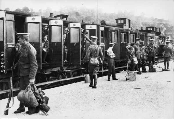 British troops boarding a train at Rouen, northern France, for the Western Front during the First World War. Date: 1914