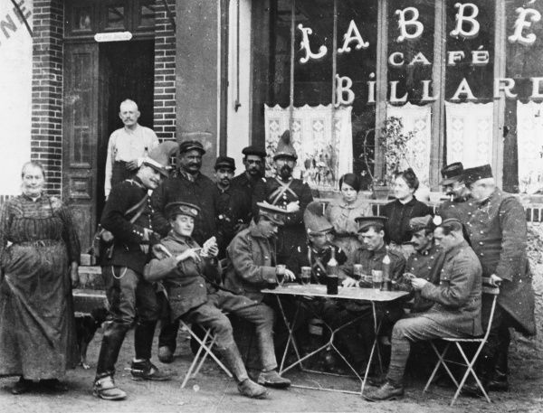British and French soldiers playing cards outside an Estaminet in Braisne on the Western Front in France during World War I on 16th October 1914 Date: 16th October 1914