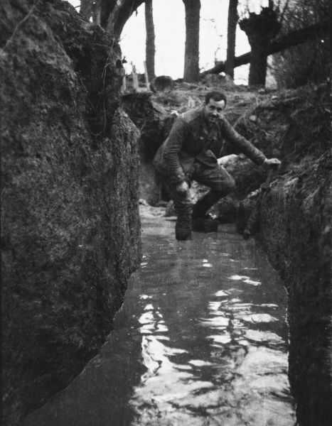 Lieutenant R C Morey of the 1st Cameronians working a pump in the communications trench between HQ and C Company in the Bois Grenier on the Western Front in France during World War I on 5th Janaury 1915