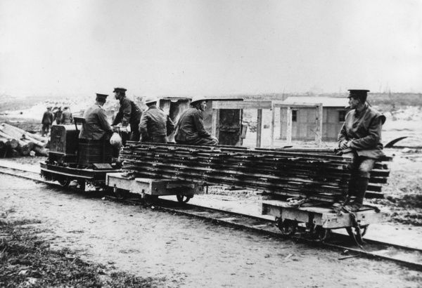 British troops laying a light railway in preparation for the advance during the First World War. Date: 1916