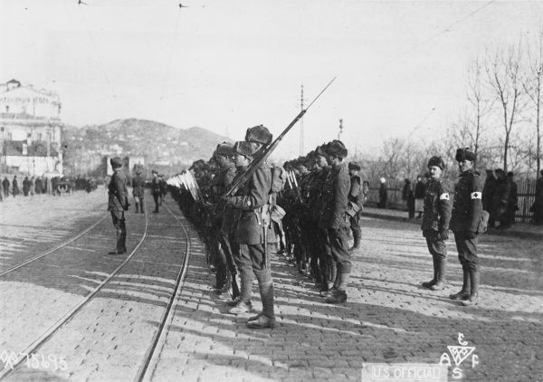 British troops, from either the 9th Battalion Hampshire Regiment or 25th Battalion Middlesex Regiment, parade in Vladivostock, their first port of call on their way to Omsk, in Siberia. The battalions formed part of the Allied Intervention Force