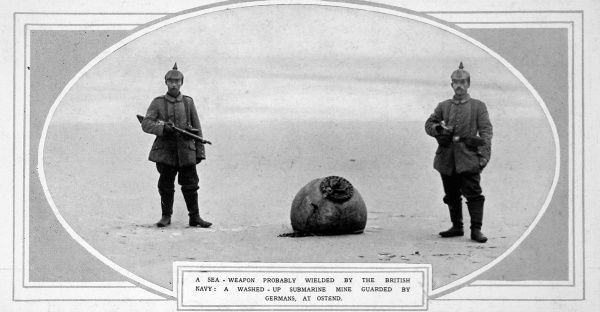 A washed-up submarine mine, probably from the British navy, guarded by two German soldiers at Ostend in Belgium