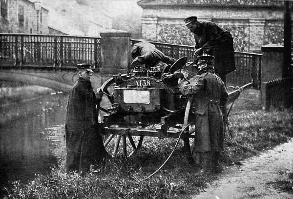 A British water-filter cart being filled from a river. Ensuring troops remained free of disease was a pressing concern during World War I, and preventative measures against water-borne bacteria, such as this mobile water-filtering unit, helped combat dysentry