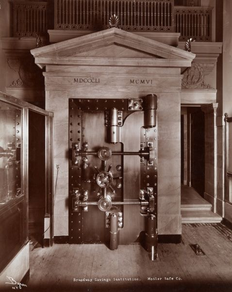 Broadway Savings Institution. Mosler Safe Co. Vault door, marble pediment above, at the Broadway Savings Institution