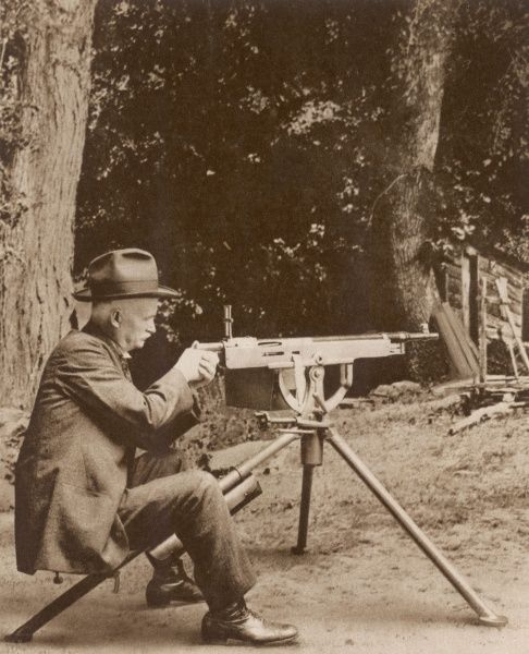BROWNING American inventor John Moses Browning with one of his machine guns