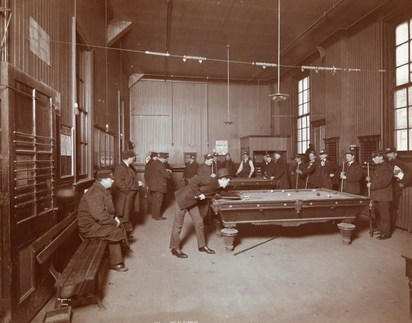 B.R.T. 58th St. Club House. - Men in uniform playing billiards in the Brooklyn Rapid Transit's 58th St. Clubhouse billiard room