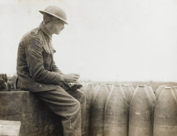 A British corporal checking a delivery of shells which have arrived by rail, on the Western Front during the First World War. Date: 1914-1918